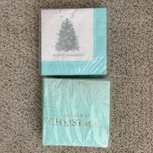 Two packages holiday napkins turquoise &white